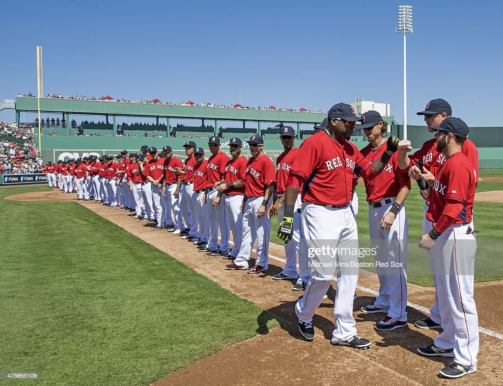 David Ortiz #34 of the Boston Red Sox is greeted by teammates Clay Buchholz #11, Jon Lester #31 and Dustin Pedroia #15 during team introductions before a Grapefruit League game against the Minnesota Twins at jetBlue Park on February 28, 2013 in Ft. Myers, FL.