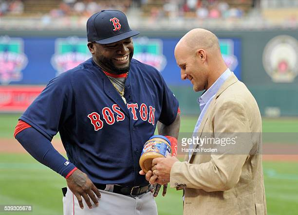 David Ortiz of the Boston Red Sox is presented with peanut butter from former teammate Corey Koskie before the game between the Minnesota Twins and...