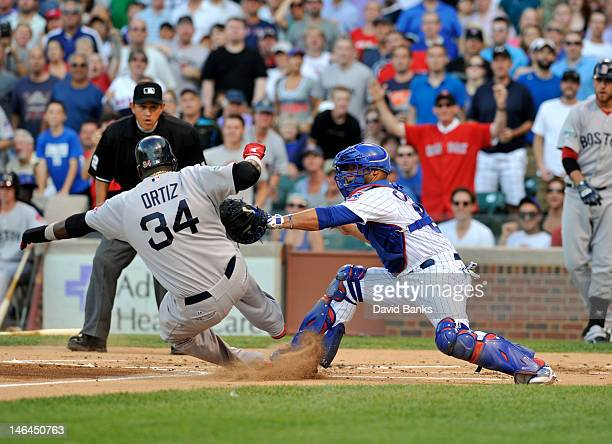 David Ortiz of the Boston Red Sox is tagged out at home by Welington Castillo of the Chicago Cubs in the first inning on June 16 2012 at Wrigley...