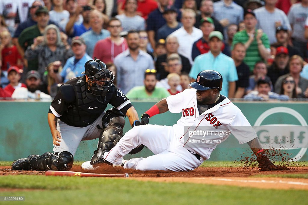 David Ortiz #34 of the Boston Red Sox is tagged out at home plate by Dioner Navarro #27 of the Chicago White Sox in the second inning during the game at Fenway Park on June 22, 2016 in Boston, Massachusetts.
