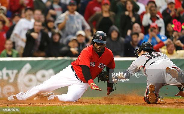 David Ortiz of the Boston Red Sox is tagged out by Yan Gomes of the Cleveland Indians in the second inning at Fenway Park on June 13 2014 in Boston...