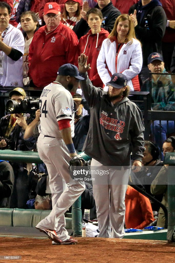 David Ortiz #34 of the Boston Red Sox is welcomed back to the dugout in the eighth inning by Jarrod Saltalamacchia #39 during Game Five of the 2013 World Series against the St. Louis Cardinals at Busch Stadium on October 28, 2013 in St Louis, Missouri.
