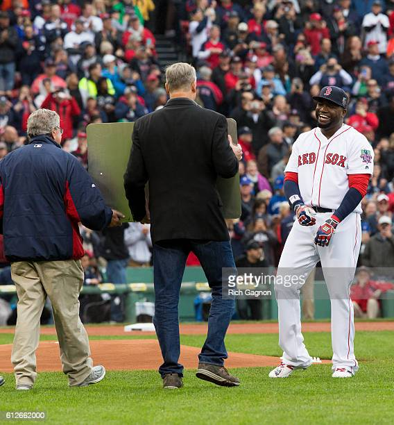 David Ortiz of the Boston Red Sox laughs as Massachusetts governor Charlie Baker holds up the sign that will soon be on the Brookline Avenue bridge...