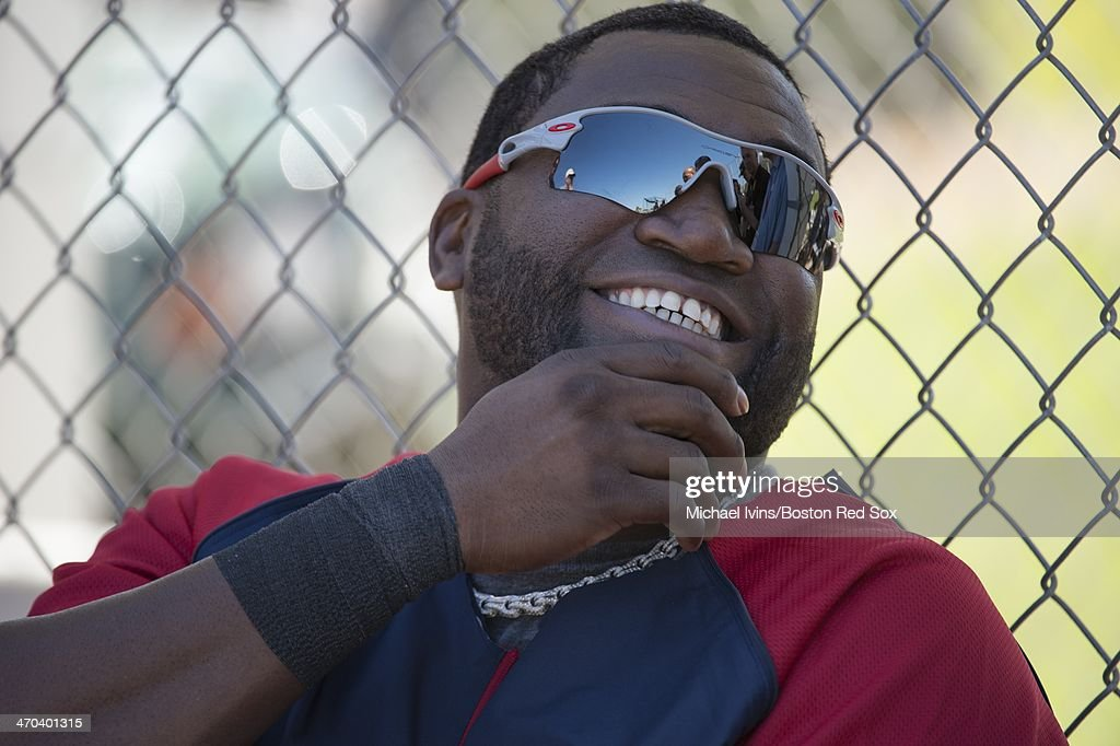 David Ortiz #34 of the Boston Red Sox laughs while informally chatting with reporters during a Spring Training workout at Fenway South on February 19, 2014 in Fort Myers, Florida.