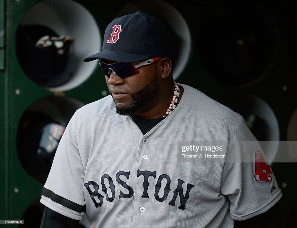 David Ortiz #34 of the Boston Red Sox looks on from the dugout before the start of their game against the Oakland Athletics at O.co Coliseum on July 13, 2013 in Oakland, California.