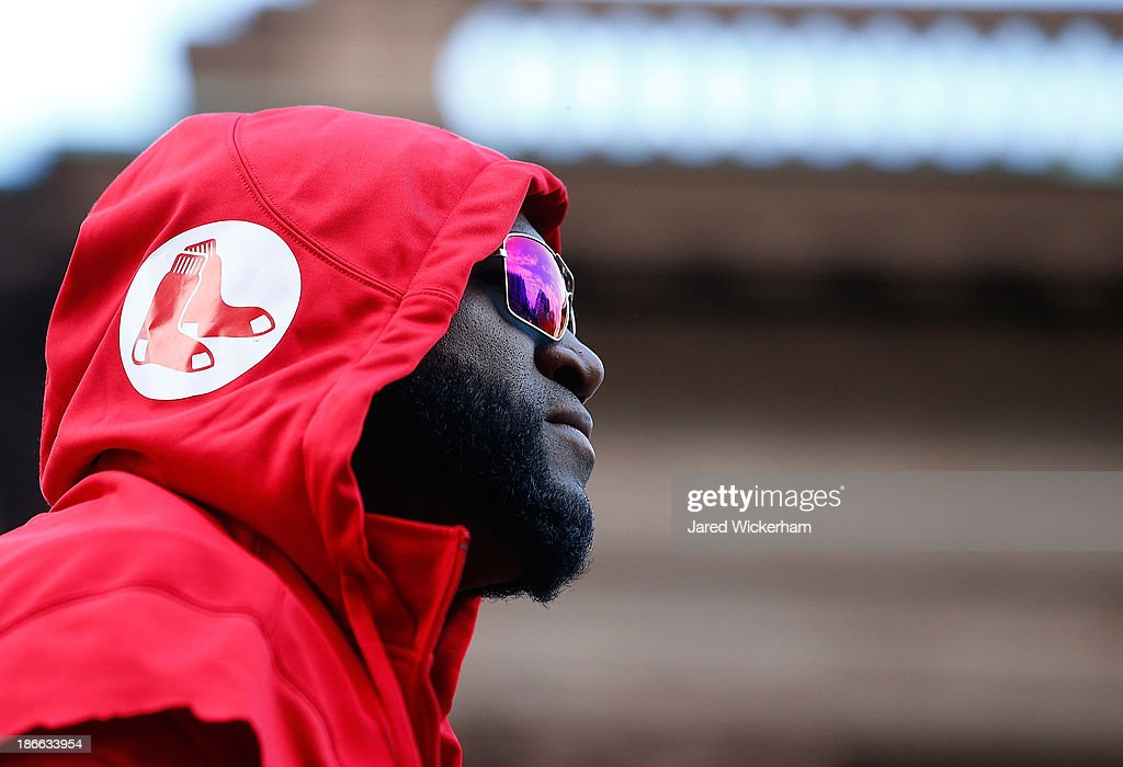 David Ortiz #34 of the Boston Red Sox looks out to the crowd from a float during the World Series victory parade on November 2, 2013 in Boston, Massachusetts.