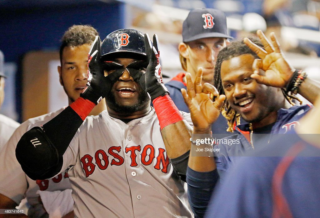 David Ortiz of the Boston Red Sox looks with teammate Hanley Ramirez to the spot where his second inning solo home run landed in the stands during...