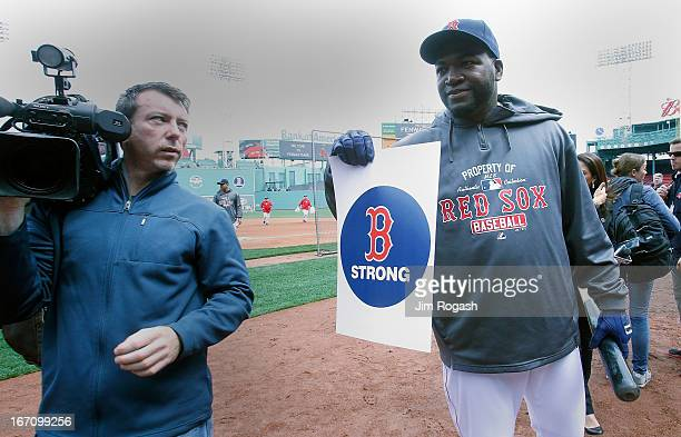 David Ortiz of the Boston Red Sox poses with a Boston Strong sign which honors the Marathon bombing victims before a game the Kansas City Royals at...