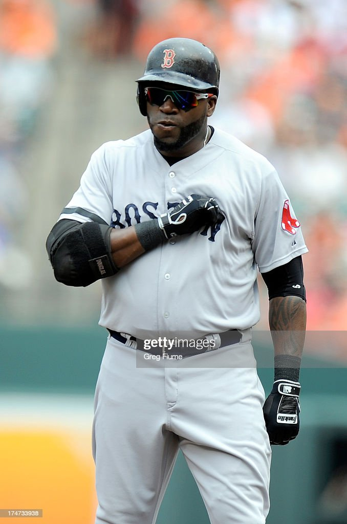 <a gi-track='captionPersonalityLinkClicked' href=/galleries/search?phrase=David+Ortiz&family=editorial&specificpeople=175825 ng-click='$event.stopPropagation()'>David Ortiz</a> #34 of the Boston Red Sox pounds his chest after hitting a single in the first inning against the Baltimore Orioles at Oriole Park at Camden Yards on July 28, 2013 in Baltimore, Maryland.
