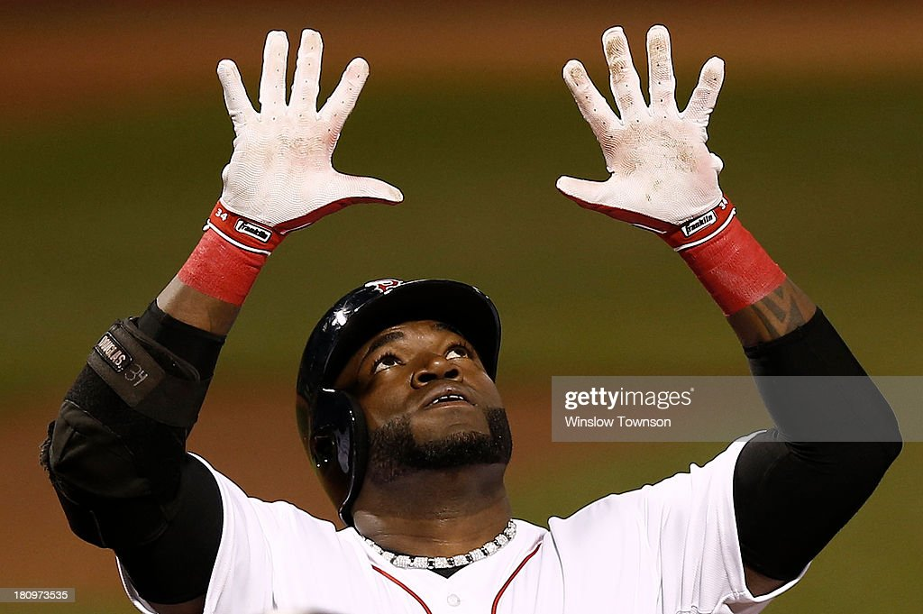 David Ortiz #34 of the Boston Red Sox reaches skyward after his two-run home run against the Baltimore Orioles during the first inning of the game at Fenway Park on September 18, 2013 in Boston, Massachusetts.