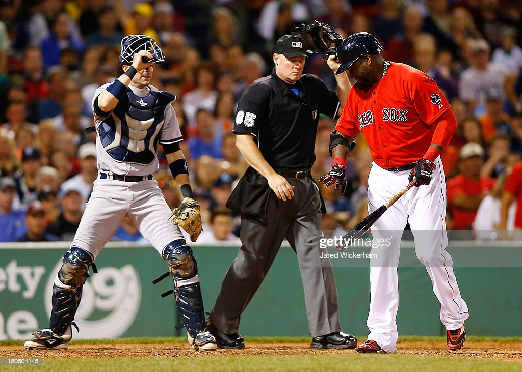 David Ortiz #34 of the Boston Red Sox reacts after being hit by a pitch in the 7th inning in front of Chris Stewart #19 of the New York Yankees during the game on September 13, 2013 at Fenway Park in Boston, Massachusetts.