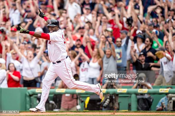 David Ortiz of the Boston Red Sox reacts after hitting a game winning walkoff single during the eleventh inning of a game against the Houston Astros...