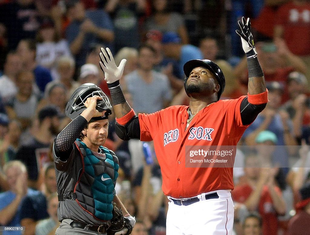 David Ortiz #34 of the Boston Red Sox reacts after hitting a home run in the seventh inning as Tuffy Gosewisch #8 of the Arizona Diamondbacks looks on at Fenway Park on August 12, 2016 in Boston, Massachusetts.