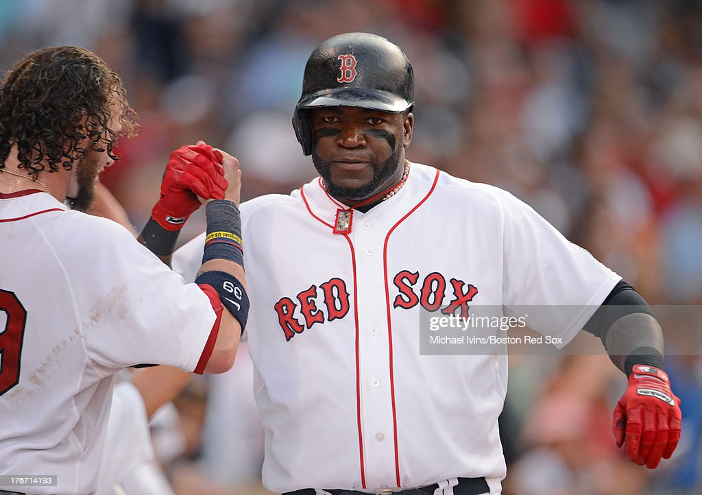 David Ortiz #34 of the Boston Red Sox reacts after hitting a home run against the New York Yankees during the seventh inning on August 17, 2013 at Fenway Park in Boston Massachusetts.