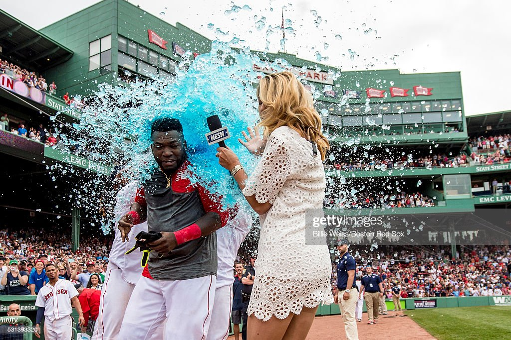 <a gi-track='captionPersonalityLinkClicked' href=/galleries/search?phrase=David+Ortiz&family=editorial&specificpeople=175825 ng-click='$event.stopPropagation()'>David Ortiz</a> #34 of the Boston Red Sox reacts as he is given a Powerade bath alongside NESN reporter Guerin Austin after hitting a game winning walk-off single during the eleventh inning of a game against the Houston Astros on May 14, 2016 at Fenway Park in Boston, Massachusetts.