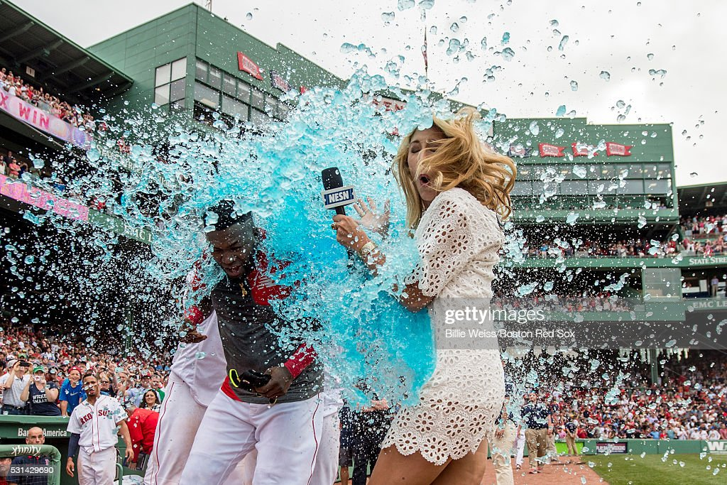 David Ortiz #34 of the Boston Red Sox reacts as he is given a Powerade bath alongside NESN reporter Guerin Austin after hitting a game winning walk-off single during the eleventh inning of a game against the Houston Astros on May 14, 2016 at Fenway Park in Boston, Massachusetts.