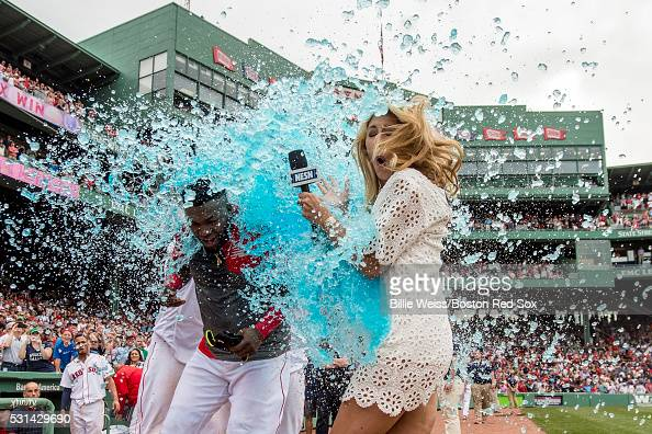 David Ortiz of the Boston Red Sox reacts as he is given a Powerade bath alongside NESN reporter Guerin Austin after hitting a game winning walkoff...