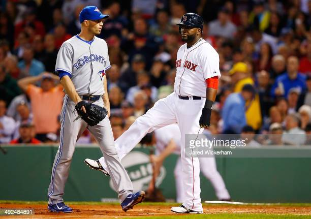David Ortiz of the Boston Red Sox reacts following a basesloaded double play to end the fourth inning in front of JA Happ of the Toronto Blue Jays...