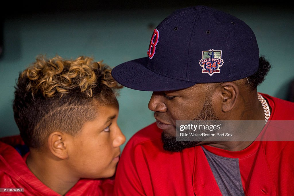 David Ortiz #34 of the Boston Red Sox reacts with his son D'Angelo Ortiz before a game against the Toronto Blue Jays on September 30, 2016 at Fenway Park in Boston, Massachusetts.