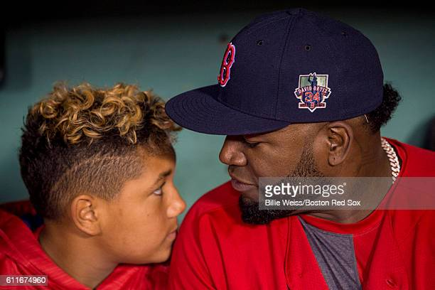 David Ortiz of the Boston Red Sox reacts with his son D'Angelo Ortiz before a game against the Toronto Blue Jays on September 30 2016 at Fenway Park...
