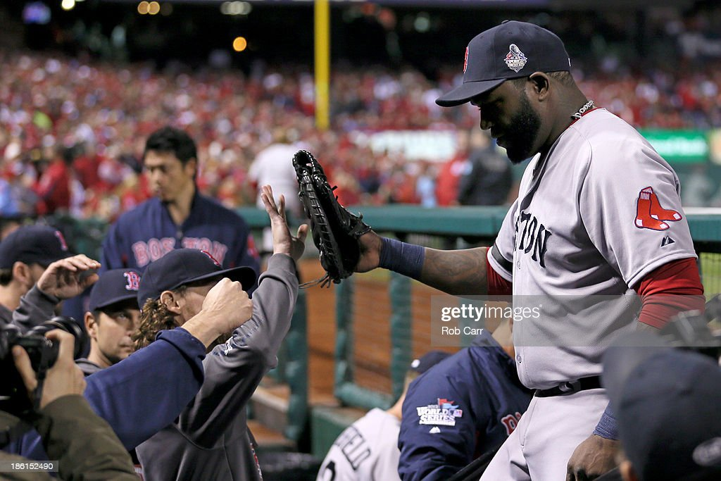David Ortiz #34 of the Boston Red Sox returns to the dugout after being removed from the game in the eighth inning of Game Five of the 2013 World Series against the St. Louis Cardinals at Busch Stadium on October 28, 2013 in St Louis, Missouri.