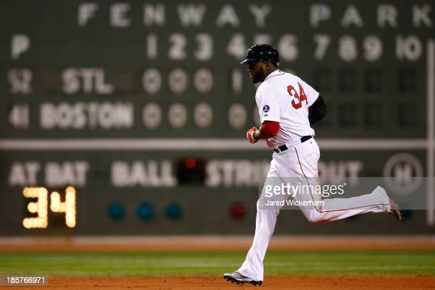 David Ortiz of the Boston Red Sox rounds the bases after hitting a two run home run in the sixth inning against the St Louis Cardinals during Game...