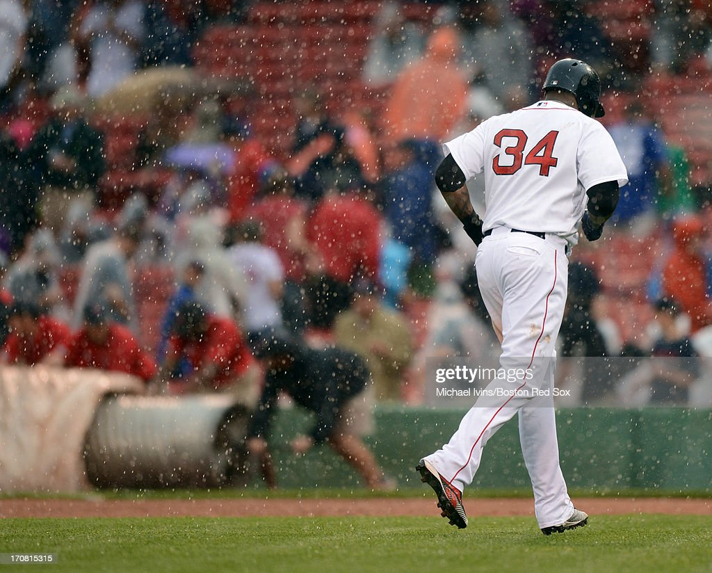 David Ortiz #34 of the Boston Red Sox runs of the field during a rain delay against the Tampa Bay Rays in the fifth inning on June 18, 2013 at Fenway Park in Boston, Massachusetts.