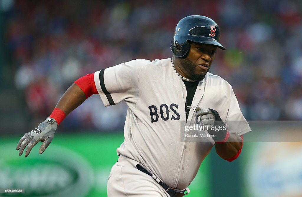 David Ortiz #34 of the Boston Red Sox runs the bases to score against the Texas Rangers at Rangers Ballpark in Arlington on May 4, 2013 in Arlington, Texas.