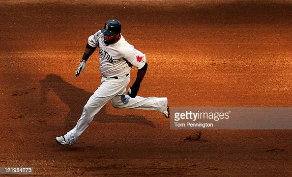 David Ortiz of the Boston Red Sox runs toward third base against the Texas Rangers at Rangers Ballpark in Arlington on August 24 2011 in Arlington...