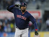David Ortiz of the Boston Red Sox salutes as he round second base after hitting a two run home run in the first inning against the New York Yankees...