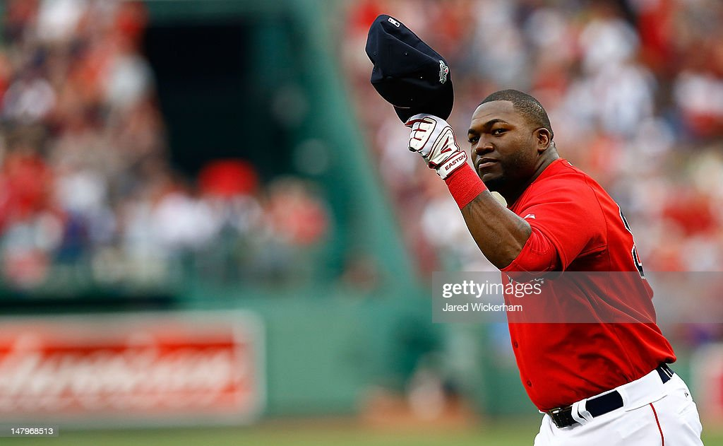 David Ortiz #34 of the Boston Red Sox salutes the crowd while being recoginized for his 400th career home run prior to the game against the New York Yankees on July 6, 2012 at Fenway Park in Boston, Massachusetts.