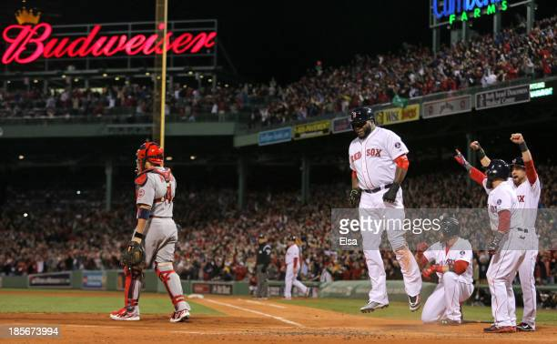 David Ortiz of the Boston Red Sox scores after a hit by Mike Napoli in the first inning against the St Louis Cardinals during Game One of the 2013...