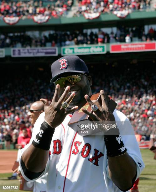 David Ortiz of the Boston Red Sox shows off his 2004 and 2007 World Series rings during season home opening ceremonies before the Red Sox play the...