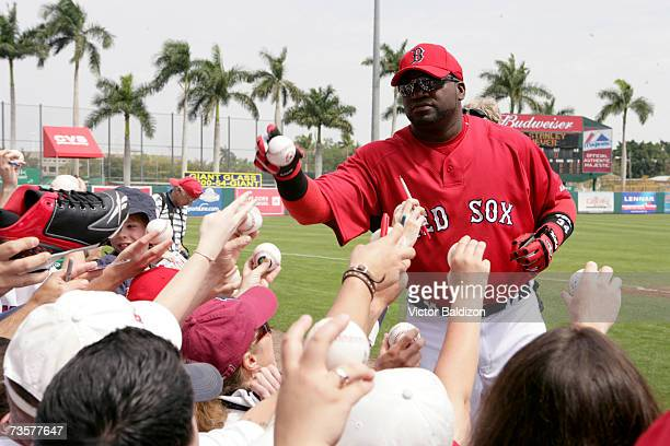 David Ortiz of the Boston Red Sox sign autographs before the game against the Pittsburgh Pirates during a Spring Training game on March 14 2007 at...