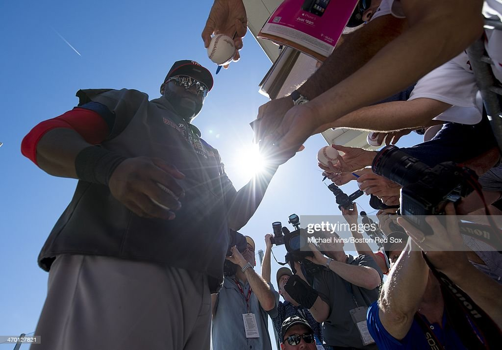 <a gi-track='captionPersonalityLinkClicked' href=/galleries/search?phrase=David+Ortiz&family=editorial&specificpeople=175825 ng-click='$event.stopPropagation()'>David Ortiz</a> #34 of the Boston Red Sox signs autographs following a Spring Training workout at Fenway South on February 18, 2014 in Fort Myers, Florida.