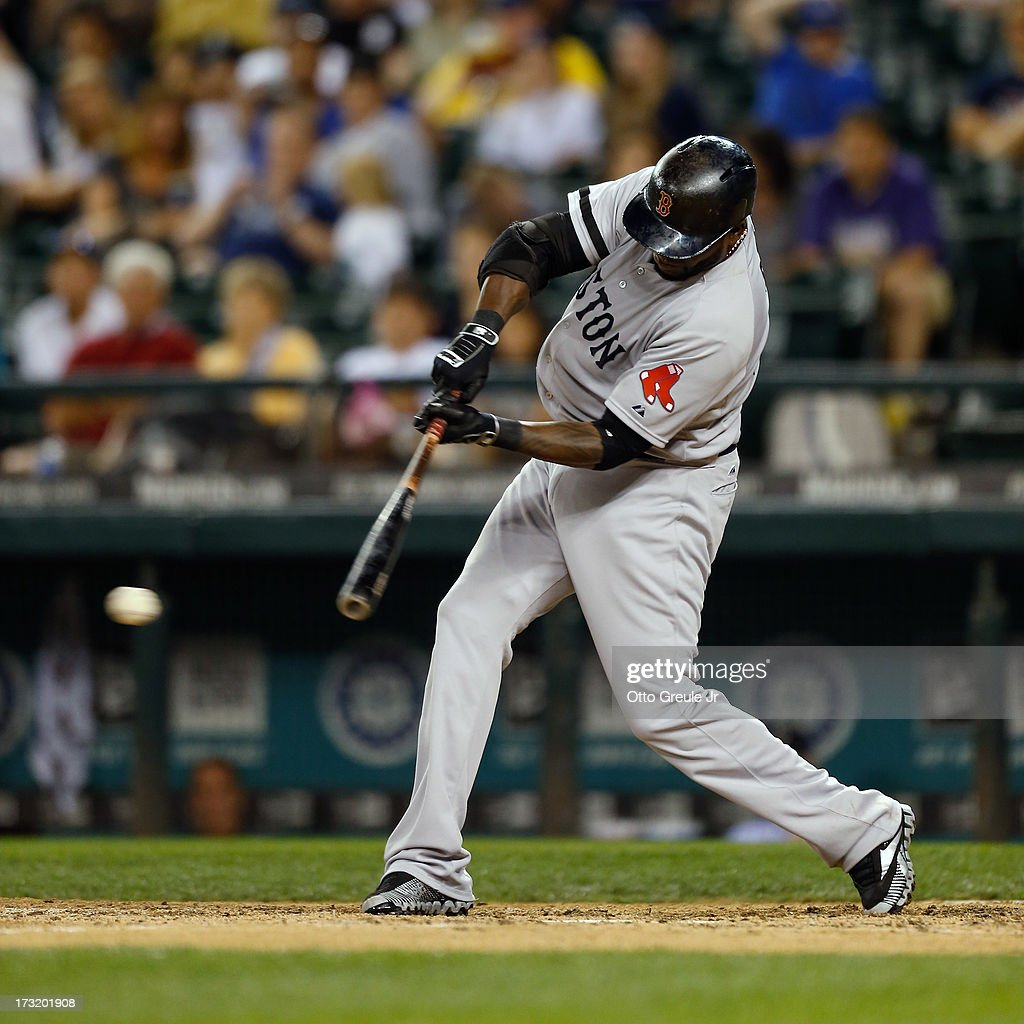 <a gi-track='captionPersonalityLinkClicked' href=/galleries/search?phrase=David+Ortiz&family=editorial&specificpeople=175825 ng-click='$event.stopPropagation()'>David Ortiz</a> #34 of the Boston Red Sox singles for his fourth hit of the game against the Seattle Mariners in the eighth inning at Safeco Field on July 9, 2013 in Seattle, Washington. The hit tied him with Harold Baines (1,688) for most hits by a designated hitter in major league history.