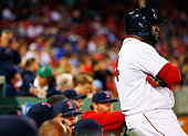 David Ortiz of the Boston Red Sox sits on the dugout railing in the 8th inning during a pitching change against the Tampa Bay Rays during the game at...