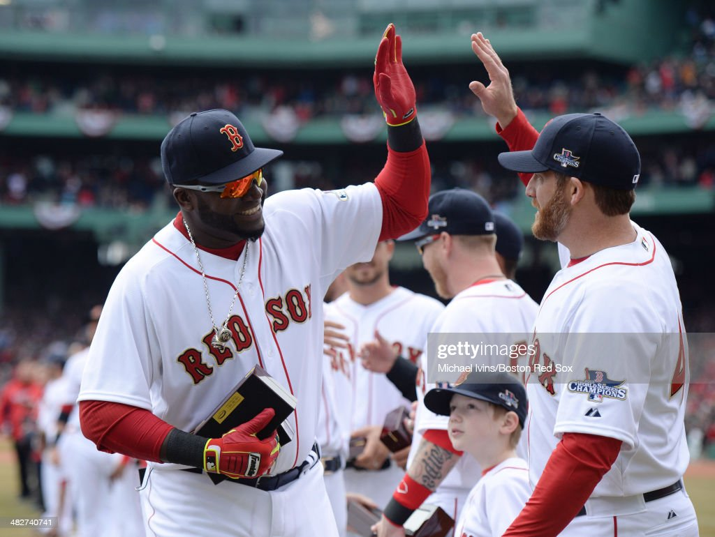 <a gi-track='captionPersonalityLinkClicked' href=/galleries/search?phrase=David+Ortiz&family=editorial&specificpeople=175825 ng-click='$event.stopPropagation()'>David Ortiz</a> #34 of the Boston Red Sox slaps hands with former teammate <a gi-track='captionPersonalityLinkClicked' href=/galleries/search?phrase=Ryan+Dempster&family=editorial&specificpeople=211606 ng-click='$event.stopPropagation()'>Ryan Dempster</a> after receiving his championship ring during a ceremony honoring the 2013 World Series Champion Boston Red Sox before the start of a game against the Milwaukee Brewers at Fenway Park on April 4, 3014 in Boston, Masschusetts.