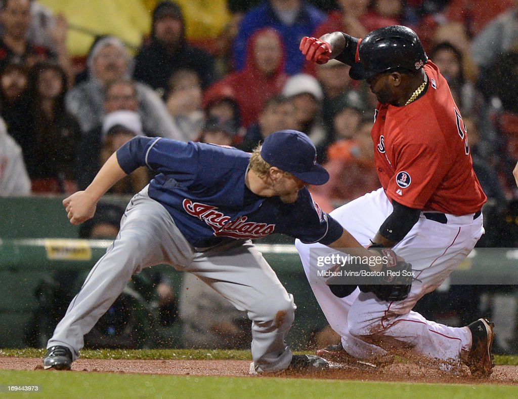 <a gi-track='captionPersonalityLinkClicked' href=/galleries/search?phrase=David+Ortiz&family=editorial&specificpeople=175825 ng-click='$event.stopPropagation()'>David Ortiz</a> #34 of the Boston Red Sox slides into third ahead of the tag by <a gi-track='captionPersonalityLinkClicked' href=/galleries/search?phrase=Mark+Reynolds+-+Baseball+Player&family=editorial&specificpeople=2343799 ng-click='$event.stopPropagation()'>Mark Reynolds</a> #12 of the Cleveland Indians in the third inning on May 24, 2013 at Fenway Park in Boston, Massachusetts.