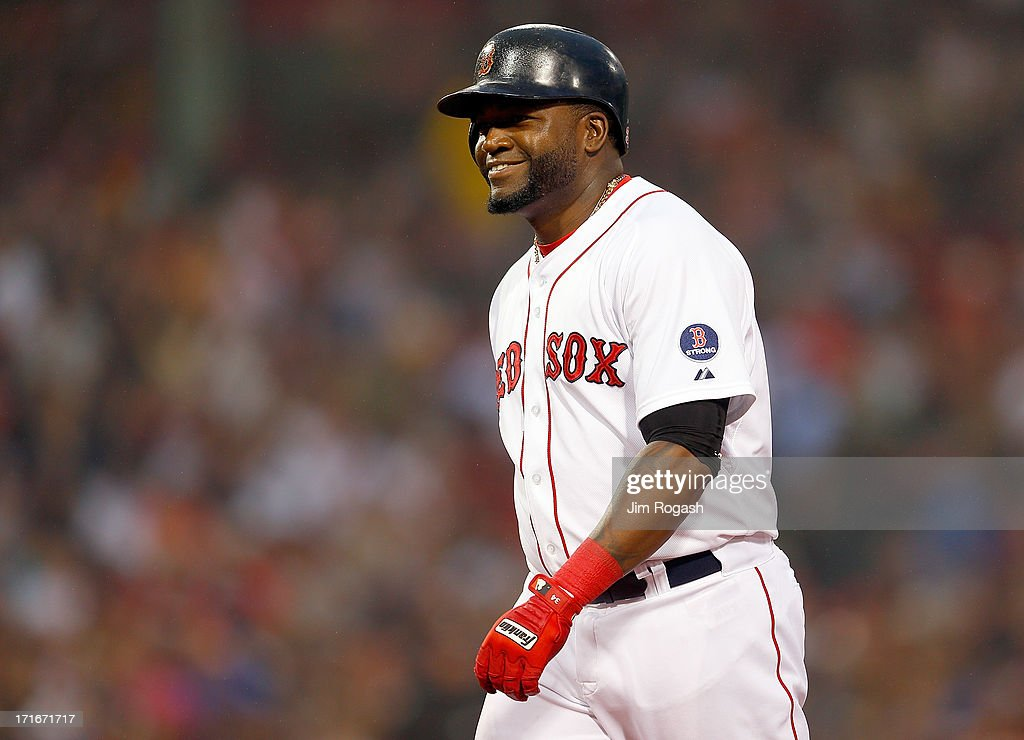 David Ortiz #34 of the Boston Red Sox smiles after he singled against the Toronto Blue Jays in the 3rd inning at Fenway Park on June 27, 2013 in Boston, Massachusetts.