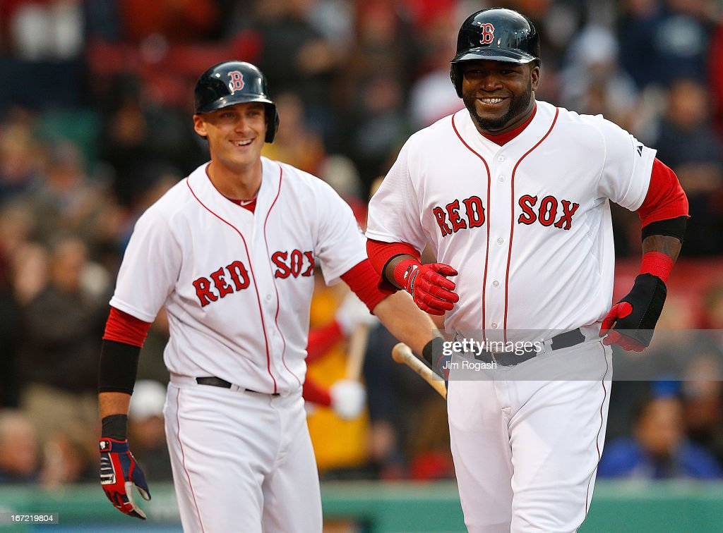 David Ortiz #34 of the Boston Red Sox smiles after scoring a run in the 2nd inning as Will Middlebrooks #16 of the Boston Red Sox looks against the Oakland Athletics at Fenway Park on April 22, 2013 in Boston, Massachusetts.
