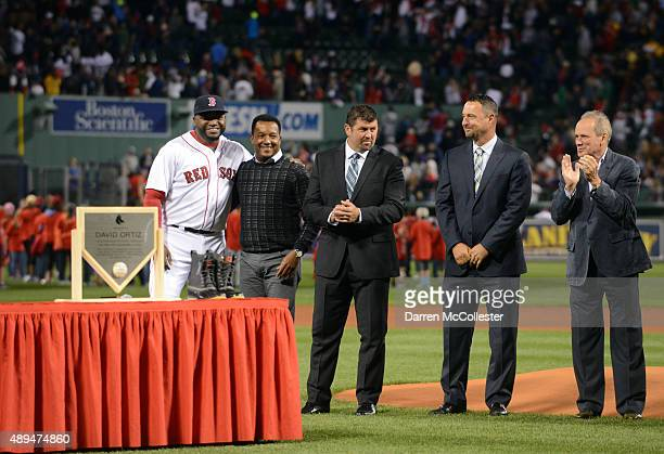 David Ortiz of the Boston Red Sox smiles as Pedro Martinez Jason Varitek Tim Wakefield and Larry Lucchino applaud during a ceremony to honor his...