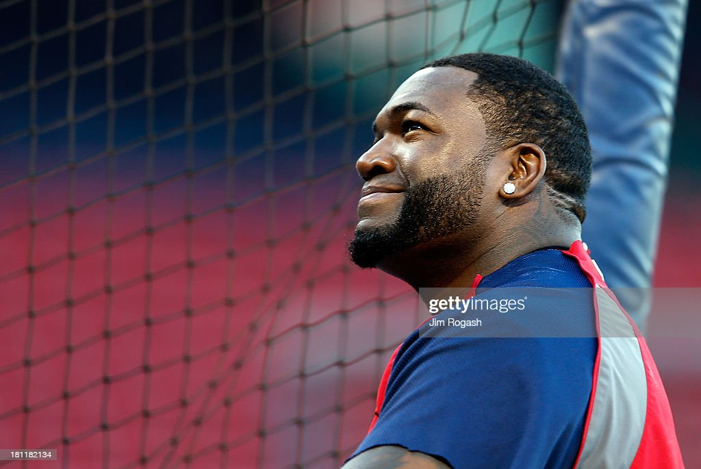 David Ortiz #34 of the Boston Red Sox smiles during batting practice before a game with the Baltimore Orioles at Fenway Park on September 19, 2013 in Boston, Massachusetts.