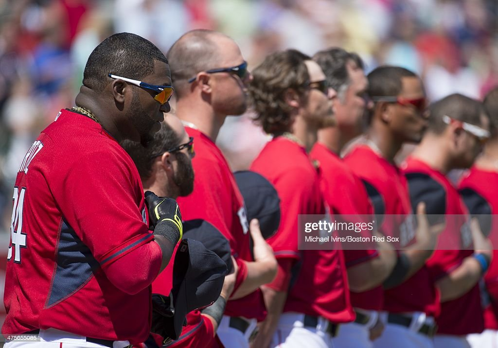 David Ortiz #34 of the Boston Red Sox stands for the national anthem with his teammates before a Grapefruit League game against the Minnesota Twins at jetBlue Park on February 28, 2013 in Ft. Myers, FL.
