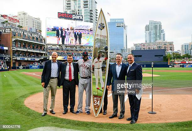 David Ortiz of the Boston Red Sox stands next to a surfboard given to him during a pregame ceremony honoring him prior to a baseball game against the...