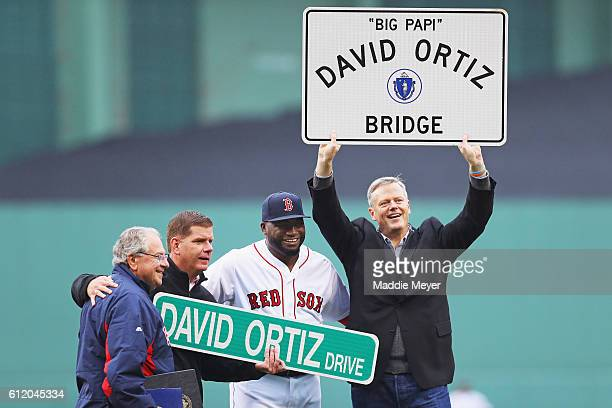 David Ortiz of the Boston Red Sox stands with Governor of Massachusetts Charlie Baker right Mayor of Boston Marty Walsh second from left and Speaker...