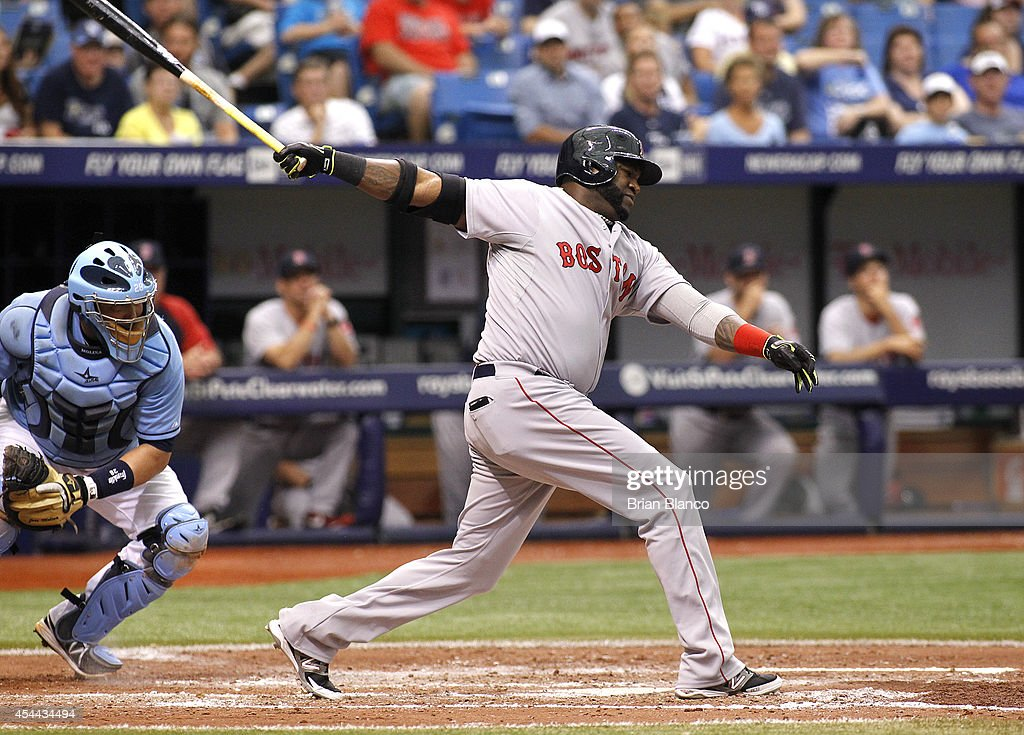 David Ortiz #34 of the Boston Red Sox strikes out swinging in front of catcher Jose Molina #28 of the Tampa Bay Rays to end the top of the fifth inning of a game on August 31, 2014 at Tropicana Field in St. Petersburg, Florida.