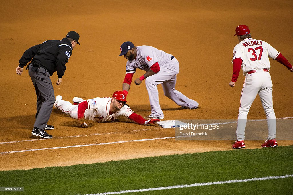 David Ortiz #34 of the Boston Red Sox tags Matt Holliday #7 of the St. Louis Cardinals to complete a double play in the bottom of the third inning during Game 3 of the 2013 World Series between the St. Louis Cardinals and the Boston Red Sox at Busch Stadium on Saturday, October 26, 2013 in St. Louis, Missouri.
