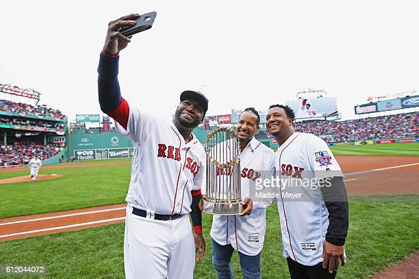 David Ortiz of the Boston Red Sox takes a selfie with Manny Ramirez and Pedro Martinez after the pregame ceremony to honor Ortiz's retirement before...
