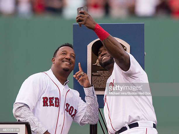 David Ortiz of the Boston Red Sox takes a 'selfie' with Pedro Martinez during a number retirement ceremony for the Hall of Fame pitcher at Fenway...